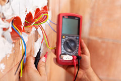Electrician working - closeup on hands Royalty Free Stock Image