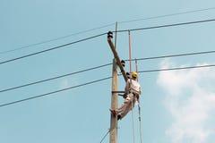 Electrician working on a crane car Stock Photos