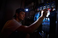 Electrician working during damage Stock Photos