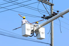 Electrician working on electric pole Royalty Free Stock Photography