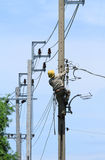 Electrician working. On electric power pole Royalty Free Stock Images