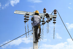 Electrician working. On electric power pole Stock Photography