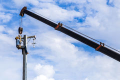 Electrician working on electric power pole stock image