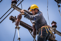 Electrician working on the electricity pole Royalty Free Stock Photo