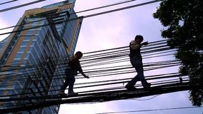 Electrician working on electricity post in Bangkok stock video