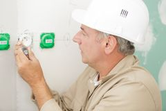 Electrician working in new home. Man royalty free stock photo