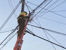 Man Repairing Electricity Telephone Pole Lines stock photos