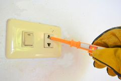 Electrician working test lamp electric shock royalty free stock photo