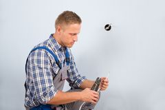 Electrician working with wire with plier Royalty Free Stock Photography