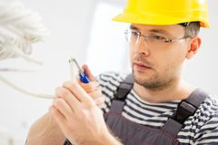 Electrician working with wires Stock Images