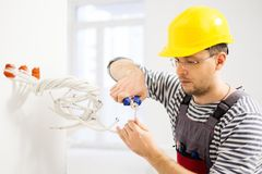 Electrician working with wires Royalty Free Stock Image