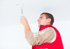 Electrician working with wires and other utensils Royalty Free Stock Image