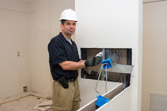 Electrician working on wiring Stock Images