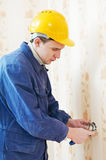 Electricians at cable wiring work Stock Photo