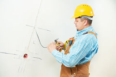 Electricians at cable wiring work Royalty Free Stock Photos