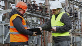 Electricians in electrical substation stock video footage
