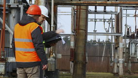 Electricians in electrical substation stock footage