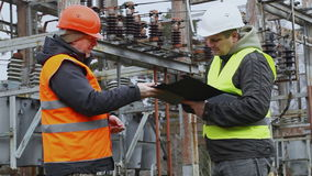 Electricians in electrical substation stock video
