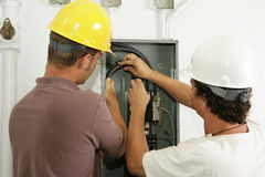 Electricians Install Panel royalty free stock images