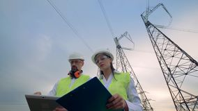 Electricians male and female discussing electrical equipment. 4K stock video footage