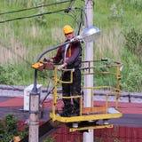 Electricians Managing basket aerial platforms. Royalty Free Stock Photo