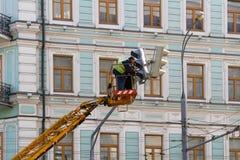 Electricians repair the traffic light Stock Photos