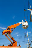 Electricians are repairing high tension power line Royalty Free Stock Image