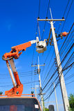 Electricians are repairing high tension power line. In thailand stock photos
