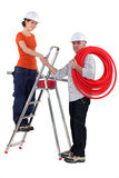 Electricians shaking hands. Electricians shaking each others hands stock image