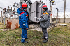Electricians at the substation Stock Photo