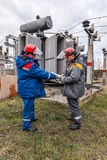 Electricians at the substation Royalty Free Stock Images
