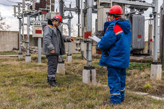 Electricians at the substation Stock Image
