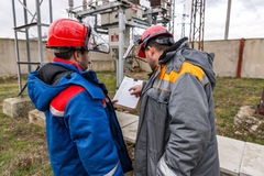 Electricians at the substation Royalty Free Stock Image