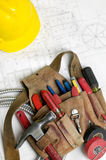 Electricians Tool Belt. Hard Hat And Electrical Plans stock images