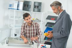Electricians troubleshooting a fault. Electricians royalty free stock images