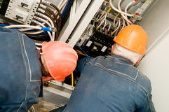 Electricians at wire installing royalty free stock photography