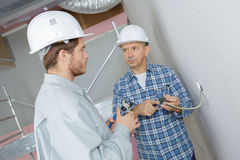 Electricians wiring new build Stock Image