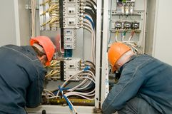 Electricians at work Stock Photos
