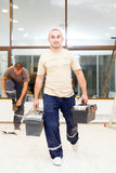 Electricians after Work with Tool Boxes Stock Photos
