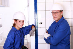 Electricians. Working on a project royalty free stock photography
