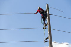 Electricians working on a pylon. Of the public power line. Fortaleza, Brazil stock image