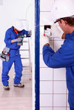 Electricians. Working together in a project royalty free stock photos