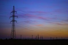 Electricidad en puesta del sol Fotos de archivo libres de regalías