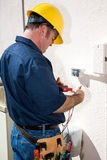 Electricista con las herramientas Imagen de archivo