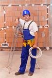 Electricista en el sitio de trabajo Foto de archivo libre de regalías