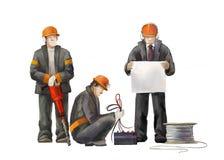 Electricista, gestor de proyecto, wBuilders del martillo del enchufe que trabajan en el ejemplo de las construcciones Fotos de archivo libres de regalías