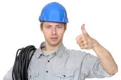 Electricista que da los pulgares para arriba Imagen de archivo libre de regalías