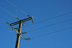 Electricity. Crossiing electric cables Royalty Free Stock Images