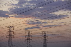 Electricity. Electrical power lines at dusk Stock Image