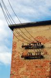 Electricity. Old red brick wall and old electric wire Stock Images